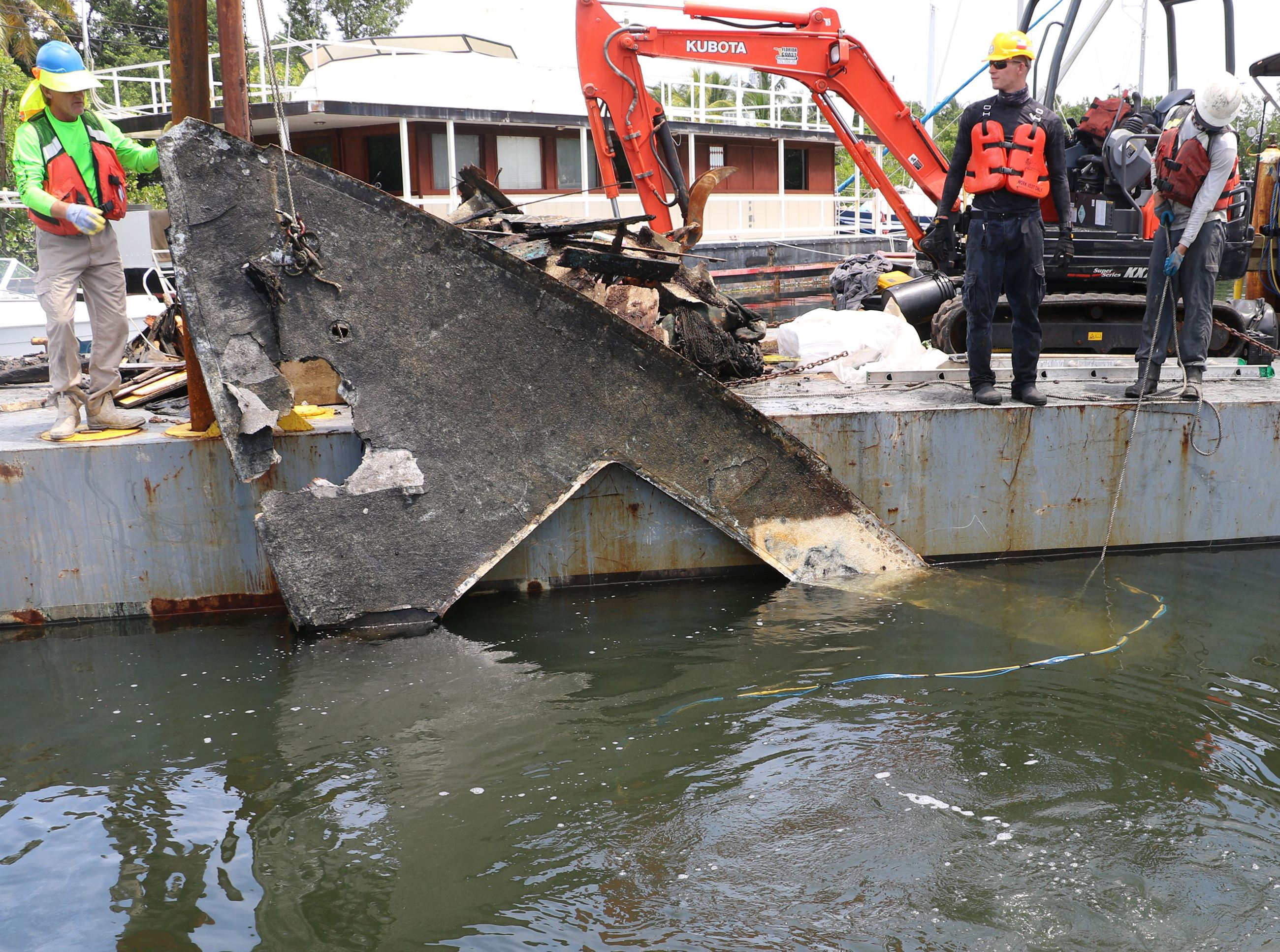 The top of a boat is removed from a Key Largo canal
