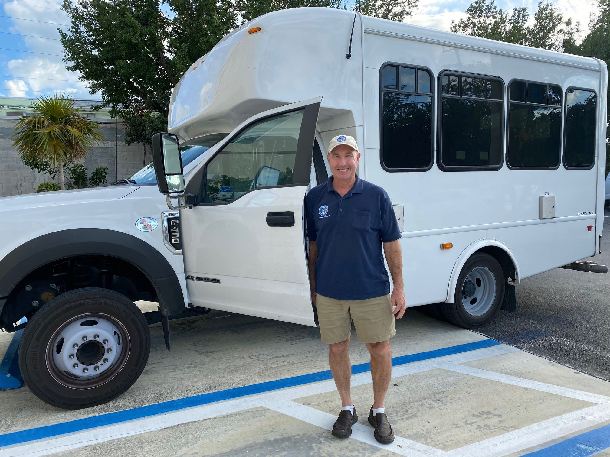 Jimmy Steffen Veterans Affairs stands in front of the veteran shuttle