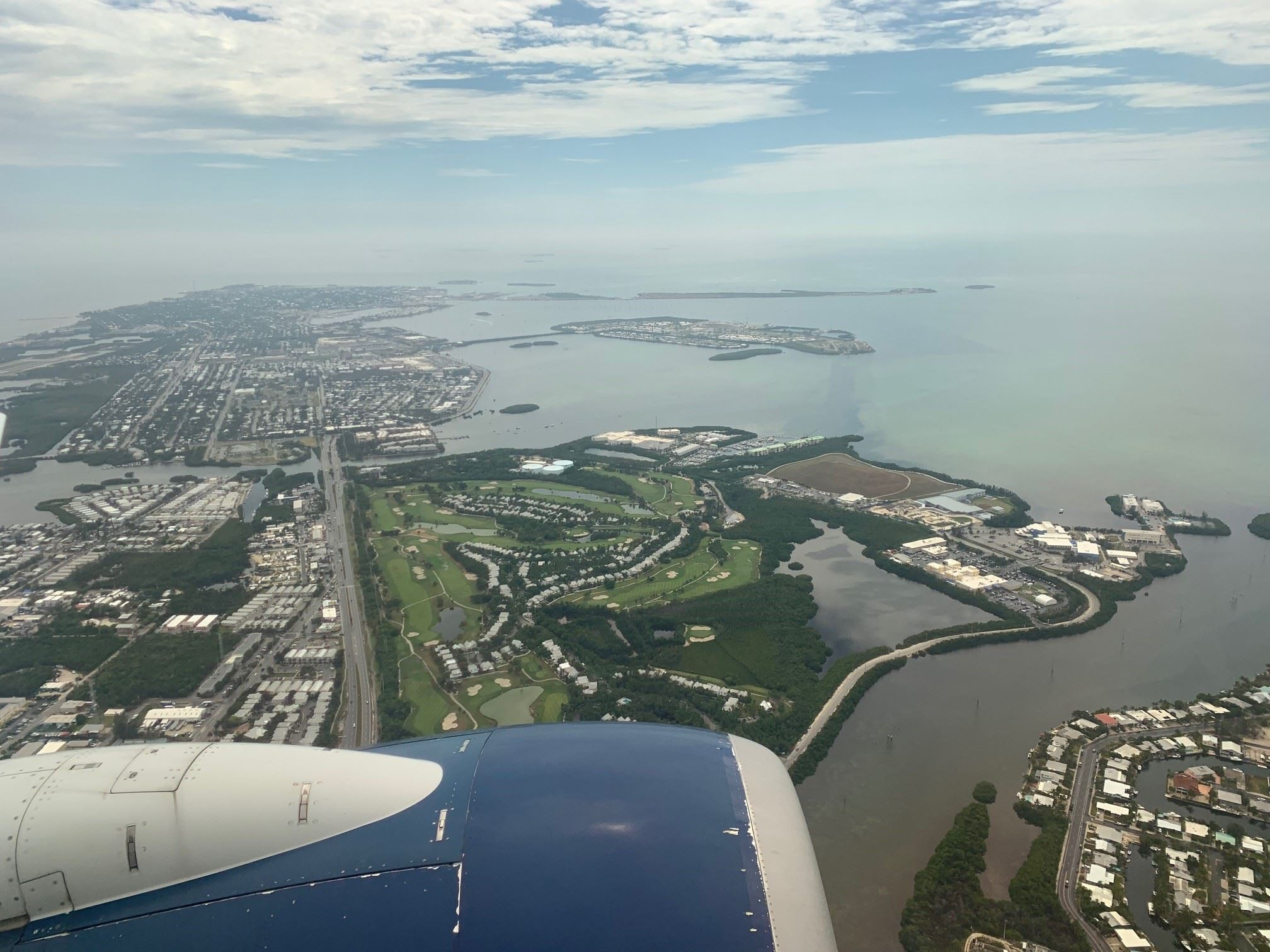 The island of Key West by air after taking off from Key West airport